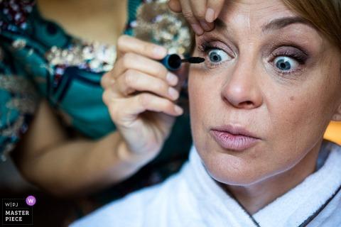 Les fermes de Marie, Megève, France wedding photographer: Bride makes a funny face during her makeup