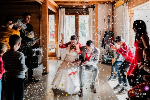 Auvergne-Rhône-Alpes wedding reception venue photography | rain of confetti on the newlyweds