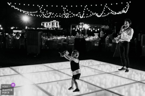 The Ritz Dubai Wedding Photos - A Small boy dancing to the saxophone