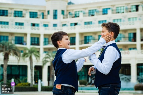 Valencia Spain Pre-Ceremony Wedding Photography - Boys slapping faces outside