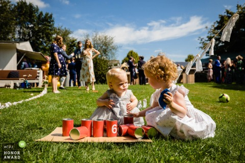 Noord Brabant wedding photo from outdoors at Heeswijk - Dinther - Playing kids on the grass at the reception