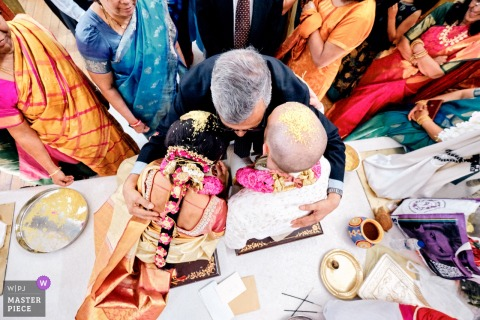 Tividale Balaji Temple Wedding Ceremony Photos | Bride and groom being blessed by guests