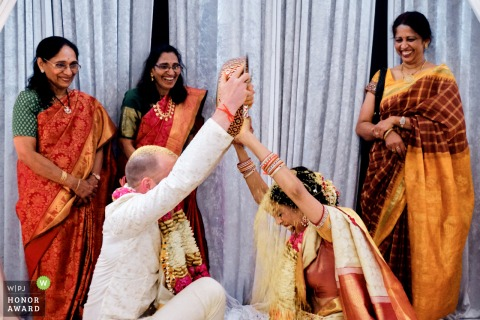 Tividale Balaji Temple photo of the Bride and groom in traditional post wedding game