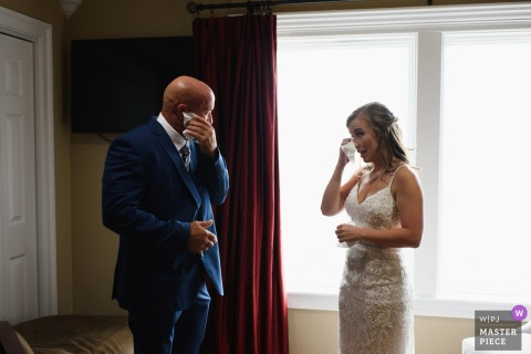 Oasis Suites, Nags Head, NC	wedding venue photographer | Emotional moment as the father sees bride for the first time