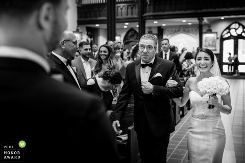 New Jersey Indoor Ceremony Photo - Bride walking down the aisle with her father as the Groom looks on and waits.