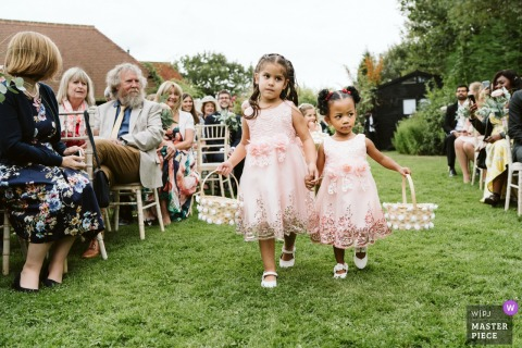 Rumbolds Farm, Surrey wedding ceremony photography outdoors - flowergirls leading the way