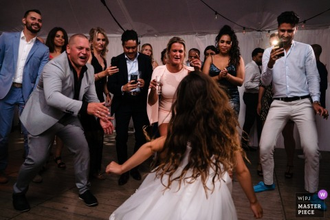 Flanders Party Photographer - Wedding Girl steals the show on the dance floor while everyone cheers for her