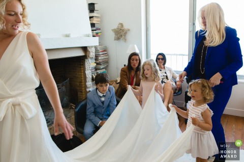 Paris France wedding photo At home before ceremony | Young girls dressed up | Child holding the dress
