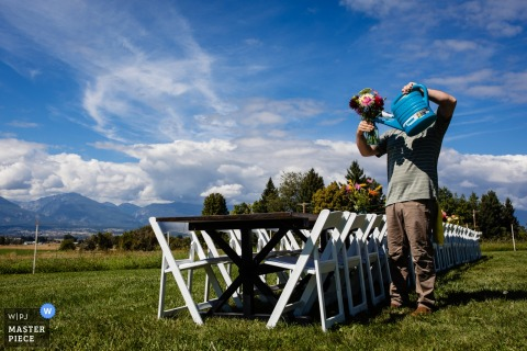 Corvallis, Montana wedding photographer - Photo of the groom watering flowers