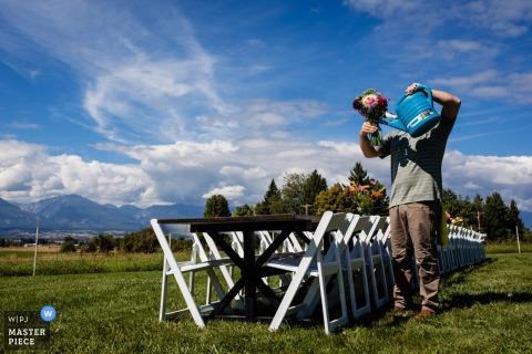 Corvallis, Montana wedding photographer - Photo of the groom watering flowers