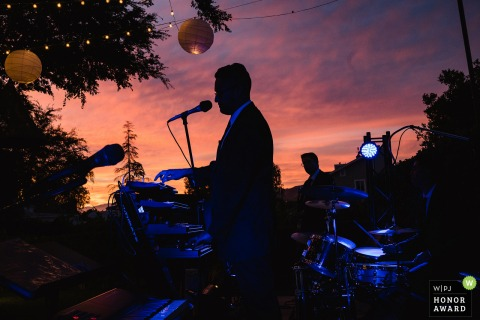 Corona, Ca wedding reception photo: The bands plays during sunset