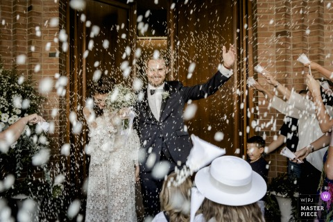 Church San Giovanni Evangelista, Empoli, Tuscany wedding photos | A rain of rice that looks like snow