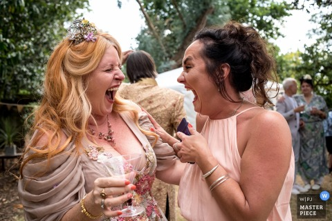 Domaine de la Rimbartière, Saint-Mars-du-Désert, Loire ATLANTIQUE - Wedding Photography of the Bride and witness sharing a joke during the cocktail