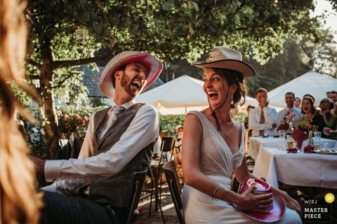 Netherlands Wedding Photographer | Bride and groom outside the ceremony and dinner location funny games