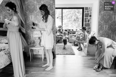 France wedding venue photographer | Domaine de Grolhier - Getting ready for the bridesmaids with dresses