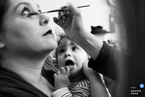 Casa de la Novia wedding preparations - daughter watching as her mother's make-up is done.