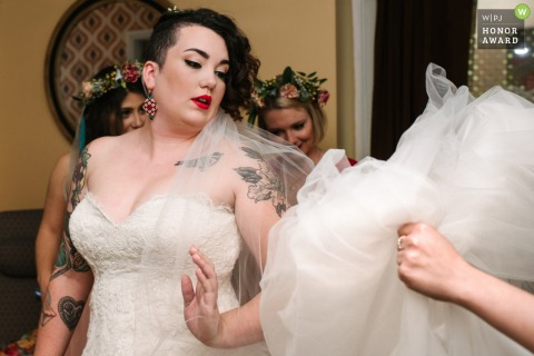 Air bnb the morning of the wedding, rented by bride and bridesmaids wedding photo: bride gets help with her dress