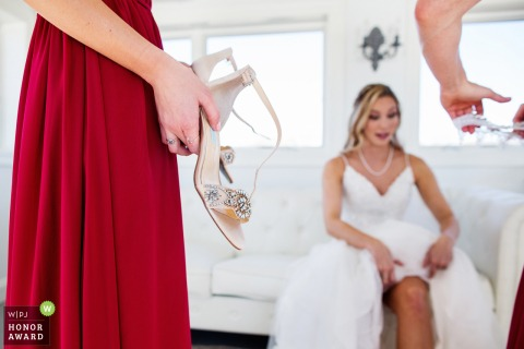 Photo: Bridesmaids have shoes and garter ready for bride at Lake Mohawk Country Club NJ wedding
