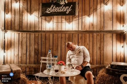 Skedenj, Ljubljana wedding reception photography of a guest Dozing off