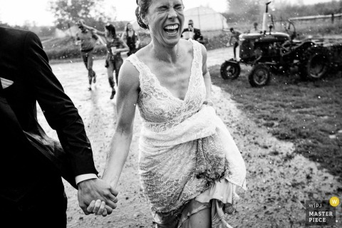 Bozeman, Montana bride running in rain - wedding photography in the mud