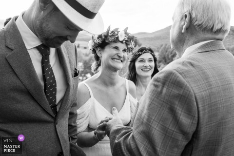 Grandby, CO outdoor wedding venue photography – Bride greeting father during ceremony