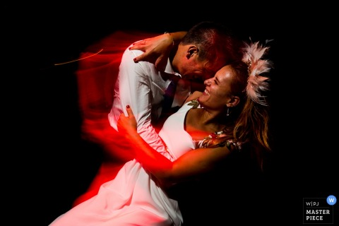 Spain Wedding Reception photography of the bride and groom at first dance with red light