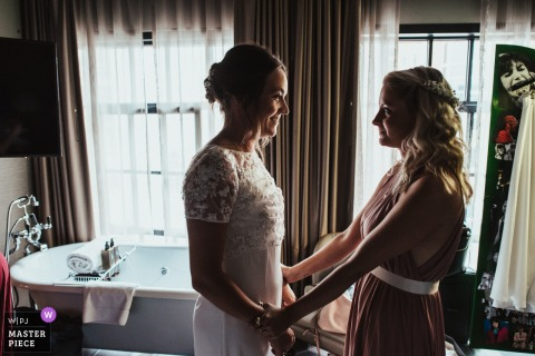 The Curtain Hotel, Hackney, London - wedding venue photos - A bride is reassured by her bridesmaid before her wedding ceremony