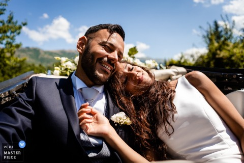 Abruzzo, Pettorano Sul Gizio - photographer rides in convertible car with the bride and groom