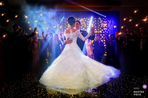 Bride and groom dancing at their wedding reception in Goias, Brazil.