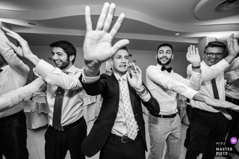 Spain wedding day photography - Dance floor energy with the men dancing with their hands