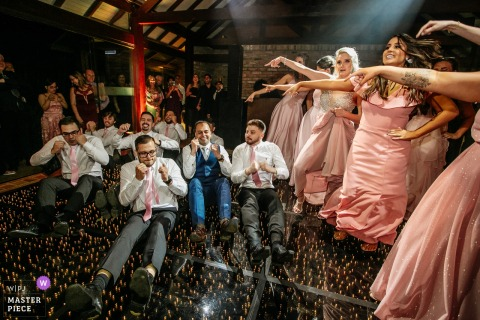 alto da capela - porto alegre - brasil - wedding photography from the reception party dance floor with the groomsmen and bridesmaids.