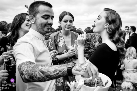 Merrydale Manor, Cheshire, UK wedding venue photographer - Canapes being served to guests at the outdoor wedding party