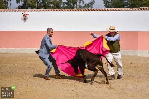 Chincha, Peru Wedding Photo: Groom and his father in law bullfighting for the guests