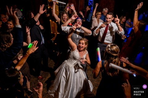 Virginia wedding photography at Bluemont Vineyard | The bride is surrounded by her friends on the dance floor.