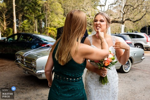 Victoria, Australia wedding photographer: The Mother of the bride checking her daughters teeth!