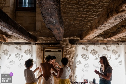 Wedding photo from Château Lagut, Périgord, France	- Bride getting ready with bridesmaids
