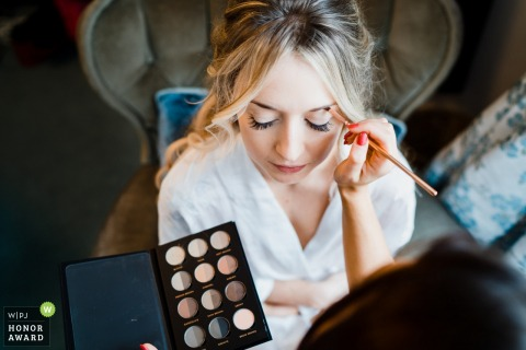 Wedding photo from the Family home in Guildford, Surrey - Bridal prep with makeup