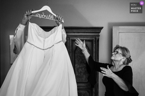 Bride's mom reaches for wedding dress from bride's dad who got it down | New Jersey wedding photographer