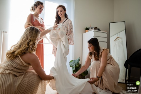 Flanders wedding photography - Lier bride getting help into her dress