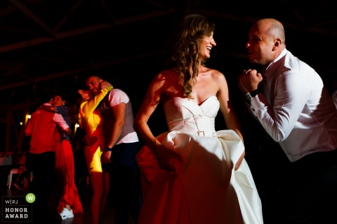 Romania wedding venue photography at Gradina Lahovari 	- Bride and groom dance during the reception party