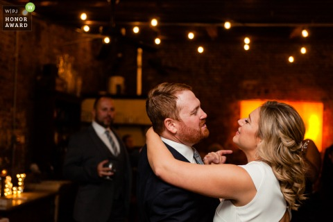 Wedding Photo at the Reception venue - Frankie's Sputino, Brooklyn, NY 	- Let them sing! Bride and groom since and dance along to their first dance song.