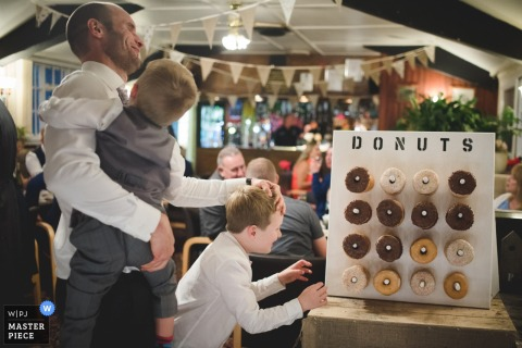 Halesowen wedding reception kids trying to get to donuts - Photography of children at the wedding.