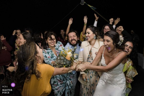On a cruise in Paraty, Costa Verde, Rio de Janeiro, Brazil - Wedding photographer: Who will get the bouquet?