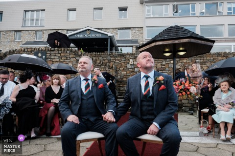 Wedding photography from the Shandon Hotel, Donegal, Ireland. - Looking a little anxiously towards the gathering clouds that would shortly bring heavy rain for their outdoor ceremony