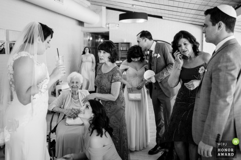 New Jersey Indoor Pre-Ceremony Photography - Hustle and bustle of the couples family moments before the ceremony starts