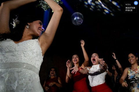 Brazil wedding photo of the bride tossing her bouquet at Bella Eventos