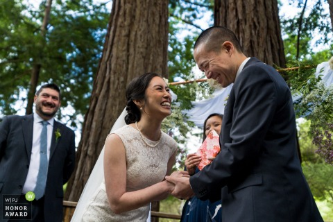 Sanborn County Park outdoor wedding venue photo: Bride and groom laughing during ceremony