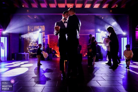 Wedding reception venue photographer - France	| First Dance with a lot of playing children