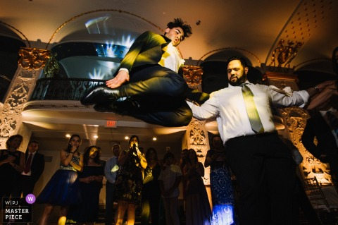 Mayflower Hotel, Washington, D.C Wedding Photographer: Bestman's special Greek dance by making the highest jump