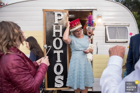 Oakland, CA, wedding reception photography. People having fun with the Photo Booth.